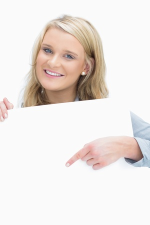 Smiling woman pointing on the piece of paper Stock Photo - 16050097