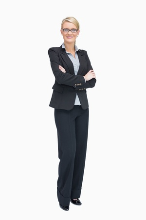 tied hair: Businesswoman standing with folded arms while smiling