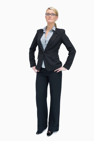 Successful businesswoman standing with her hands on the hip Stock Photo - 16050111