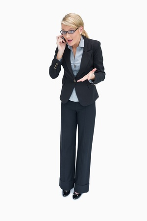 phon: Angry businesswoman having argument on mobile phon