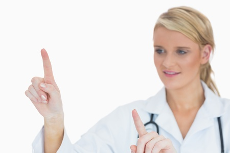 Female doctor in labcoat presenting something Stock Photo - 16050368