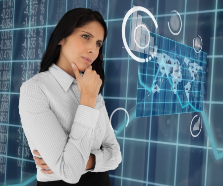 world thinking: Business woman standing thinking and looking at holographic world map Stock Photo