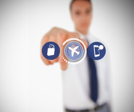 Businessman touching on airplane symbol from hologram menu photo