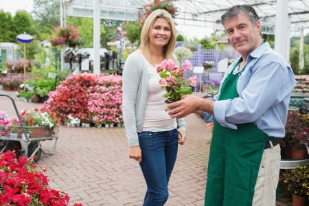 Woman buying a plant at the garden center Stock Photo - 16075739