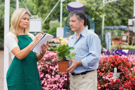 Assistant helping the customer in garden centre Stock Photo - 16078712