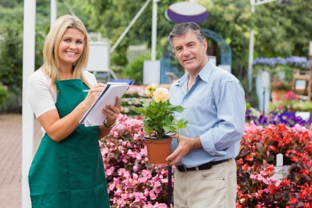 Florist taking notes while explaining to customer in garden center Stock Photo - 16078703