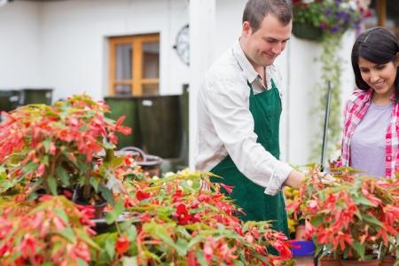 Customer and garden center worker discussing plants in garden center Stock Photo - 16068276