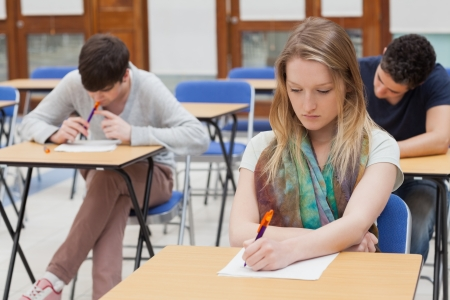 Female student sitting at table at the classroom photo