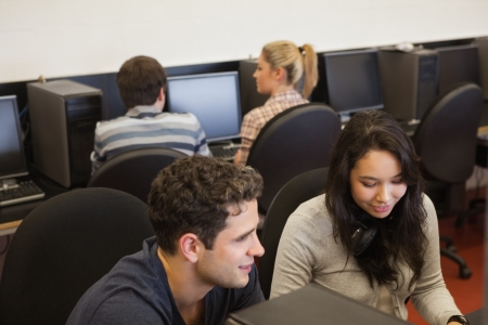 Four people in college computer class Stock Photo - 16077163