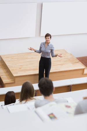 lecturing hall: Teacher standing while talking to the students