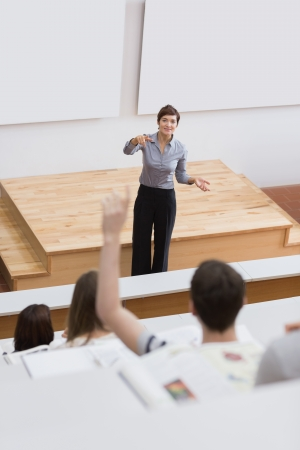 lecturing hall: Student is asking question in lecture