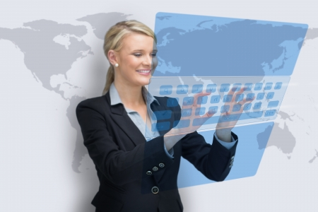 Business woman typing on holographic keyboard on world map background photo