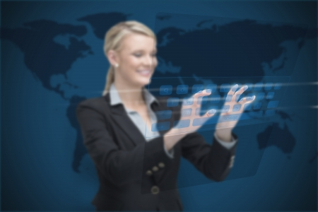 Businesswoman standing smiling while typing on digital keyboard on world map background photo