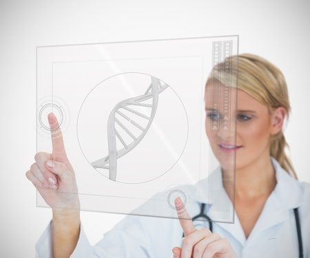 dna helix: Woman standing while looking at DNA helix hologram interface