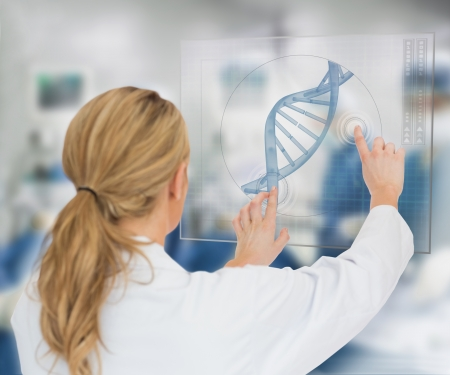dna helix: Woman using DNA helix interface hologram