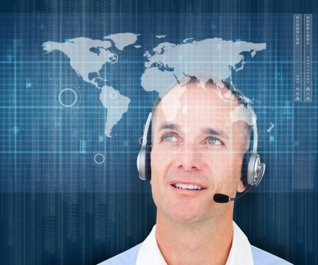 Man smiling while wearing a headset on global map background photo