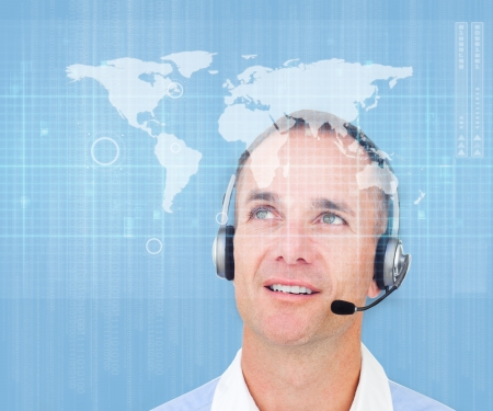 Man smiling against light blue global map background wearing a headset photo