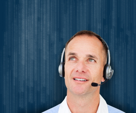 Businessman wearing head set against blue background photo