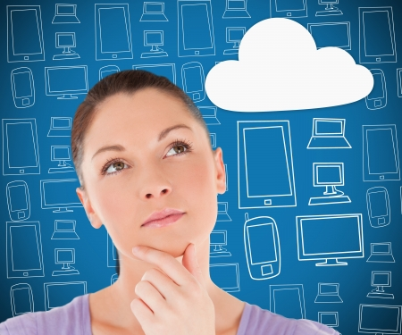 Woman thinking about cloud computing on blue multimedia theme background photo