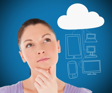 Woman considering cloud computing against blue background photo