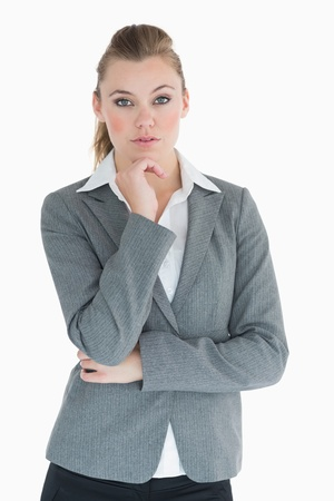 Serious businesswoman being thoughtful Stock Photo