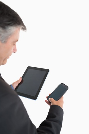 Businessman holding tablet pc and mobile phone in his hands photo