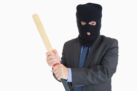 thievery: Smiling businessman dressing like a burglar while holding a baseball bat