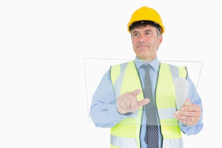 Architect pointing on pane as digital tablet while smiling photo