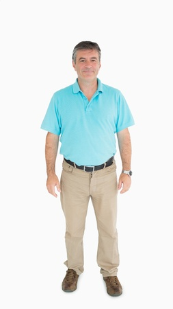 chinos: Smiling man standing in casual clothes