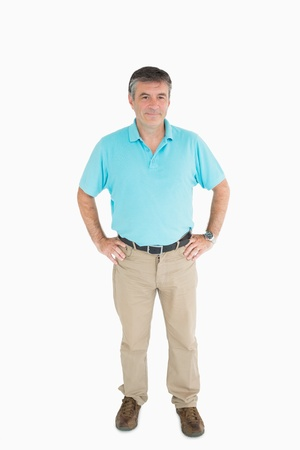 out of context: Smiling man with hands on hips wearing casual clothers Stock Photo