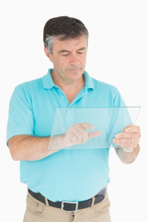chinos: Man pointing on glass slide as digital tablet while looking thoughtful Stock Photo