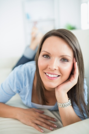 Woman looking happy on sofa in the living room Stock Photo - 16054889