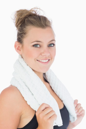 health fair: Woman standing and smiling while holding a white towel over shoulders