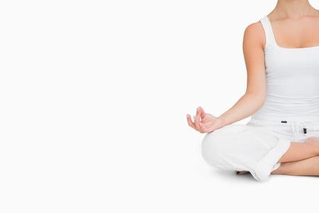 yoga  pose: Woman doing yoga pose while sitting cross legged Stock Photo