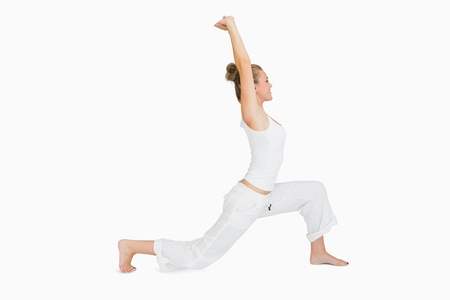Woman stretching in low lunge yoga pose photo