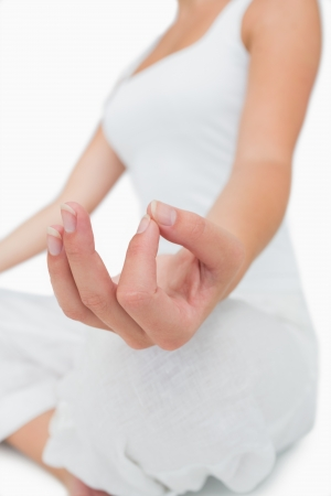 Girl sitting meditating in gian mudra yoga pose photo