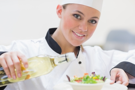Smiling chef preparing a salad in the kitchen Stock Photo - 16052849