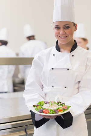 Chef showing her salad in the kitchen  photo