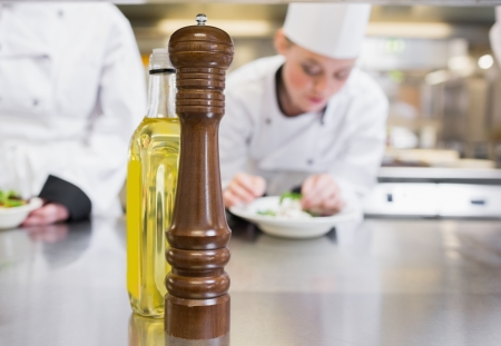 pepper grinder: Olive oil and pepper grinder on counter of busy kitchen
