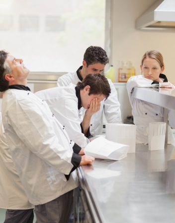 exasperated: Frustrated Chefs discussing the menu n kitchen Stock Photo