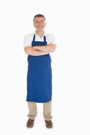 out of context: Laughing man dressed in blue apron  Stock Photo