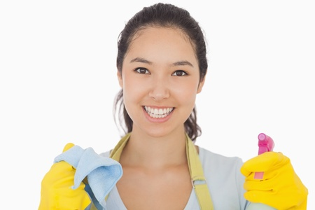 cleaning service: Smiling woman in rubber gloves with cloth and spray bottle Stock Photo