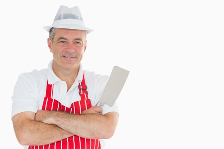 cleaver: Smiling butcher with meat cleaver and crossed arms