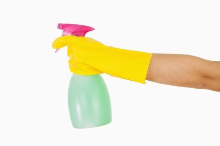 out of context: Woman in yellow rubber gloves holding window cleaner in spray bottle