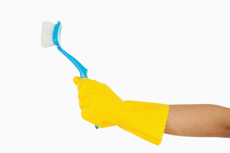 scrubbing up: Womans hand in rubber glove holding scrubbing brush