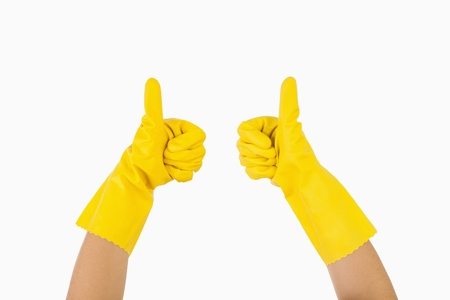 out of context: Female hands in rubber gloves showing thumbs up  Stock Photo