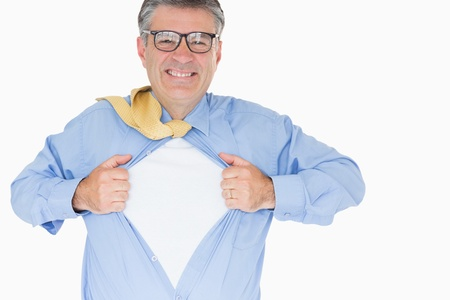 Man with glasses is pulling his shirt with his hands like a superhero photo