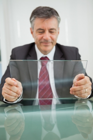 Man looking at his virtual screen on his desk in his office photo