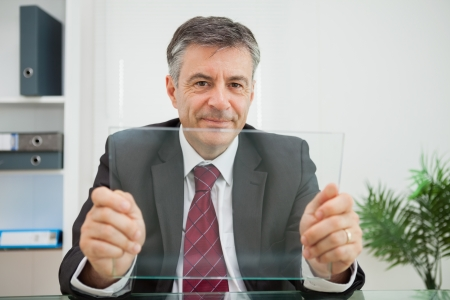 Businessman with a virtual screen photo