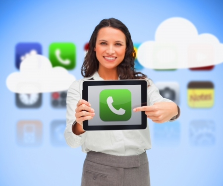 Businesswoman holding a tablet computer while smiling against background of phone applications and clouds photo